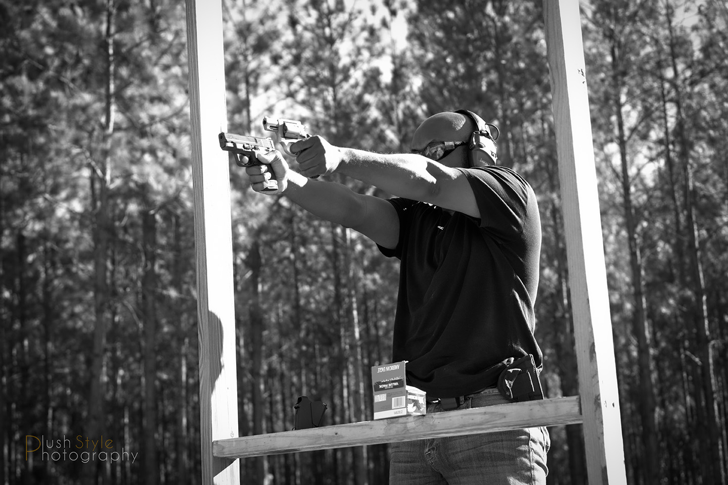 Shooting 2 guns at the range image